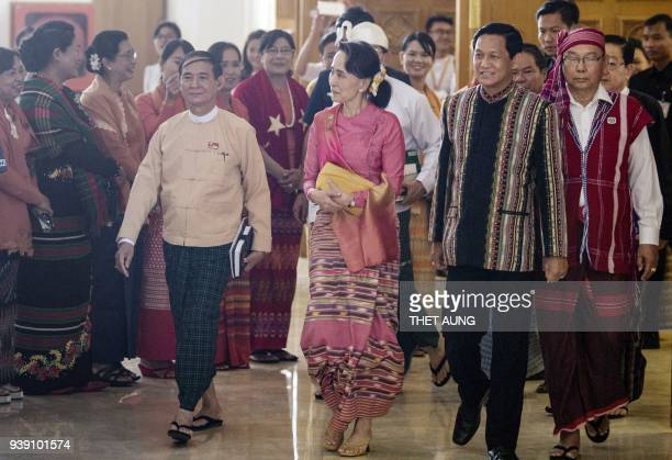 Myanmar's State Counselor Aung San Suu Kyi Win Myint and Henry Van Thio arrive at the voting ceremony to elect Myanmar's new president during a Union...