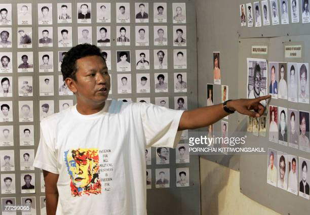 Myanmarunrestprisoners by Charlie McDonaldGibson This photo taken 26 September 2007 shows Bo Kyi the joint secretary of Mae Sotbased AAPP explaining...