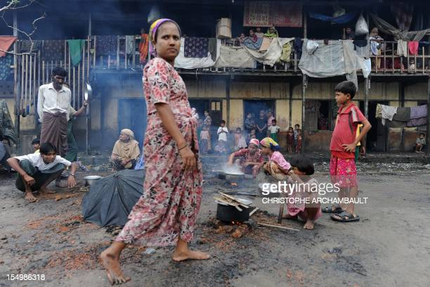 Myanmar-unrest-religion-migration,FOCUS by Amelie Bottollier-Depois This picture taken on October 11, 2012 shows Muslim Rohingyas cooking in the...