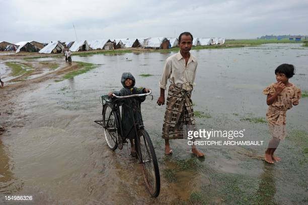 Myanmar-unrest-religion-migration,FOCUS by Amelie Bottollier-Depois This picture taken on October 11, 2012 shows a Muslim Rohingya child pushing a...