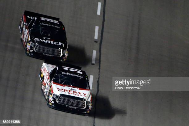 Myatt Snider driver of the Liberty Tax Service Toyota leads Noah Gragson driver of the Switch Toyota during the NASCAR Camping World Truck Series JAG...