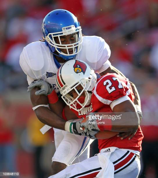 Mychal Bailey of the Kentucky Wildcats tackles Doug Beaumont of the Louisville Cardinals during the game at Papa John's Cardinal Stadium on September...