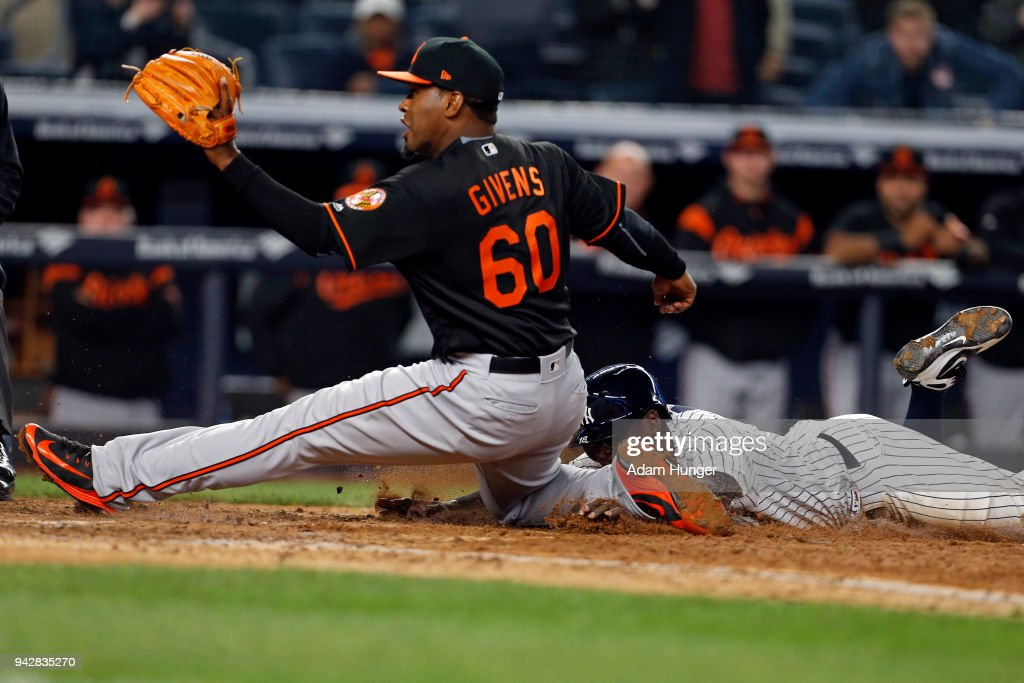 Mychal Givens #60 of the Baltimore Orioles tags out Didi Gregorius #18 of the New York Yankees during the eleventh inning at Yankee Stadium on April 6, 2018 in the Bronx borough of New York City.