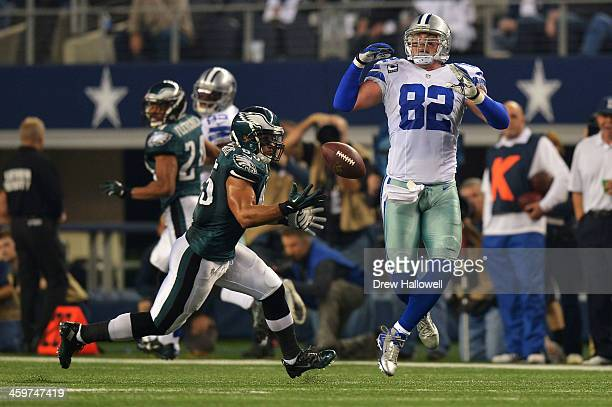 Mychal Kendricks of the Philadelphia Eagles intercepts a pass off of a deflection by Jason Witten of the Dallas Cowboys at ATT Stadium on December 29...