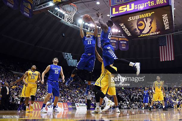 Mychal Mulder and Alex Poythress of the Kentucky Wildcats go for loose ball during the first half of a game against the LSU Tigers at the Pete...
