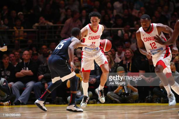 Mychal Mulder of Canada dribbles the ball during the game against Kemba Walker of USA on August 26 2019 at Qudos Bank Arena in Sydney Australia NOTE...