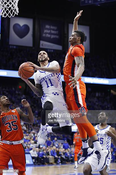 Mychal Mulder of the Kentucky Wildcats drives to the basket against Horace Spencer of the Auburn Tigers in the second half of the game at Rupp Arena...