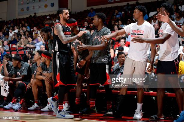 Mychal Mulder of the Toronto Raptors high fives his teammates during the game against the New Orleans Pelicans during the 2017 Las Vegas Summer...