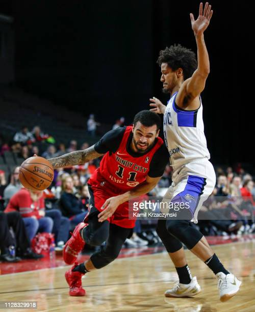 Mychal Mulder of the Windy City Bulls drives to the basket against Braian AngolaRodas of the Lakeland Magic during the second half of an NBA GLeague...