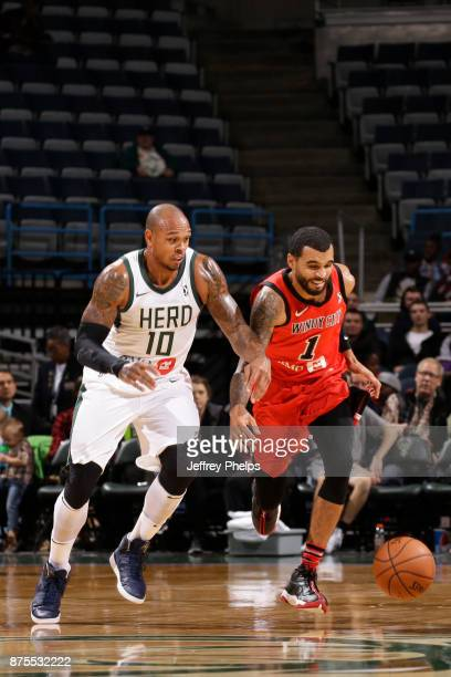 Mychal Mulder of the Windy City Bulls fights for a ball against the Shannon Brown of the Wisconsin Herd in an NBA GLeague game on November 17 2017 at...