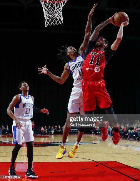 Mychal Mulder of the Windy City Bulls goes to the basket against Braian AngolaRodas of the Lakeland Magic during the first half of an NBA GLeague...