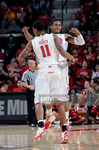 Mychal Parker and Terrell Stoglin of the Maryland Terrapins celebrate during the game against the UNCW Seahawks at the Comcast Center on November 13...