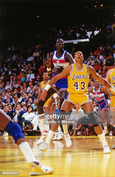 1fe997bb0ff4 Mychal Thompson of the Los Angeles Lakers boxes out against Manute Bol of  the Washington Bullets