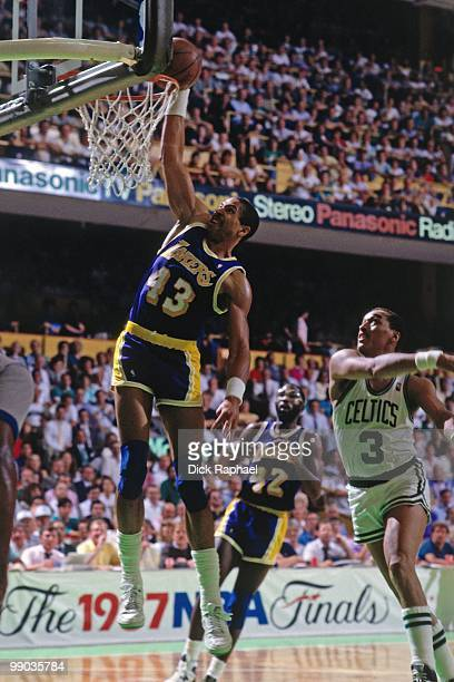 Mychal Thompson of the Los Angeles Lakers dunks against Dennis Johnson of the Boston Garden during the 1987 NBA Finals at the Boston Garden in Boston...