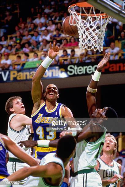 Mychal Thompson of the Los Angeles Lakers shoots against Robert Parish of the Boston Celtics during the 1987 NBA Finals circa 1987 at the Boston...