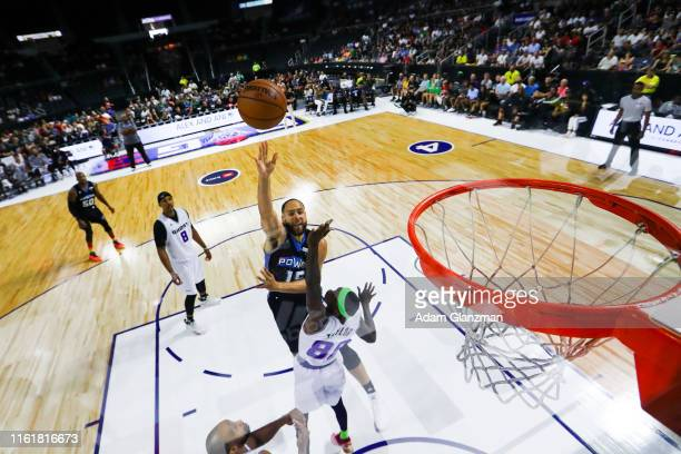 Mychel Thompson of the Power shoots the ball against Mike Taylor of the Ghost Ballers during week four of the BIG3 three on three basketball league...