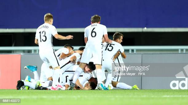 Myer Bevan of New Zealand is swarmed by teammates after scoring a goal during the FIFA U20 World Cup Korea Republic 2017 group E match between New...
