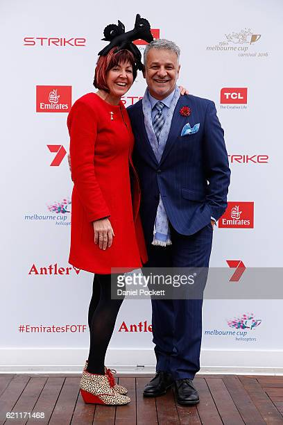 Myer Milliner Kim Fletcher and Dom Bagnato pose at the Emirates Fashion of the Field Marquee on Emirates Stakes Day at Flemington Racecourse on...