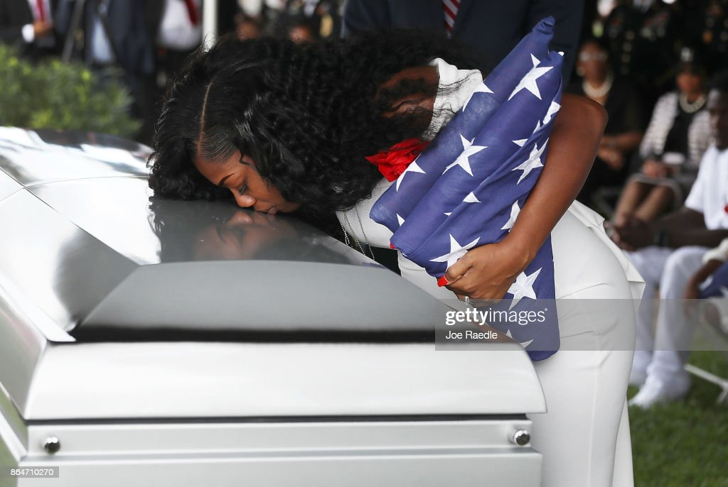 Image result for Myeshia Johnson kisses the casket of her husband, Army Sgt. La David Johnson during his burial service at the Memorial Gardens East cemetery, Oct. 21, 2017 in Hollywood, Fla.