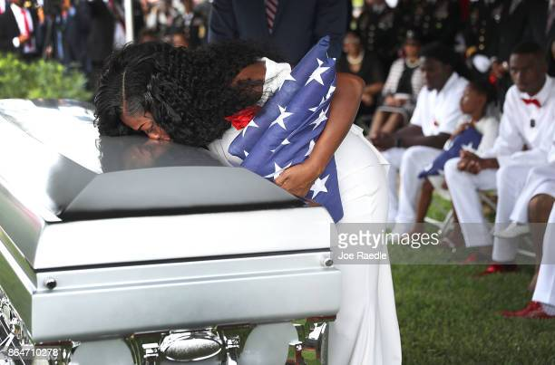 Myeshia Johnson kisses the casket of her husband US Army Sgt La David Johnson during his burial service at the Memorial Gardens East cemetery on...