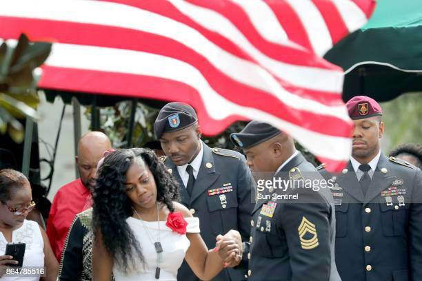 Myeshia Johnson the wife of Army Sgt La David Johnson looks down at his casket after the burial at Fred Hunter's Hollywood Memorial Gardens in...