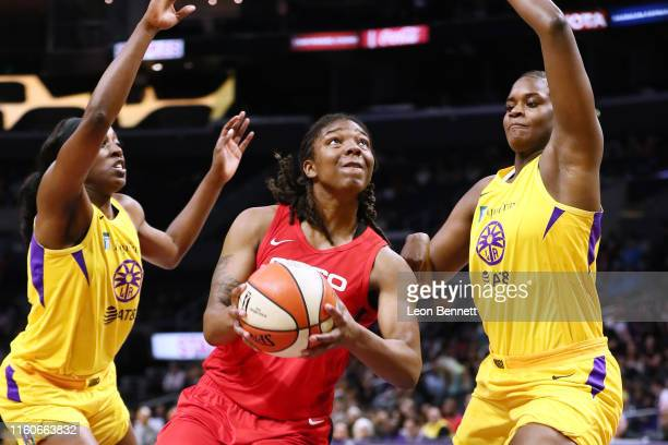Myisha HinesAllen of the Washington Mystics handles the ball against Chiney Ogwumike and Kalani Brown of the Los Angeles Sparks during a WNBA...