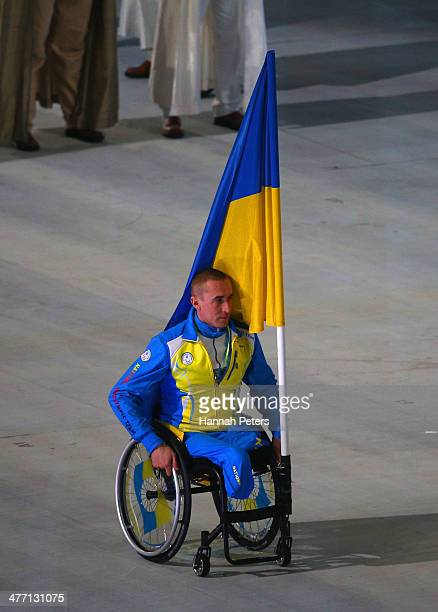Mykailo Tkachenko of Ukraine bears the flag during the Opening Ceremony of the Sochi 2014 Paralympic Winter Games at Fisht Olympic Stadium on March 7...