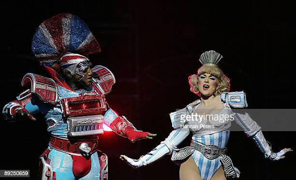 Mykal Rand who plays the character 'Electra' appears on stage with Torum Heng who plays the character 'Dinah' in 'Starlight Express' during the...