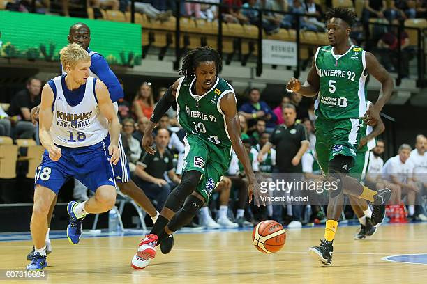 Mykal Riley of Nanterre and Viacheslav Zaytsev of Khimki Moscow during the match for the 3rd and 4th place between Nanterre and Khimki Moscow at...