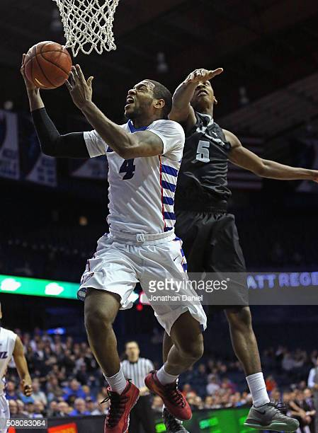 Myke Henry of the DePaul Blue Demons goes up for a shot past Rodney Bullock of the Providence Friars on his way to a gamehigh 27 points at Allstate...