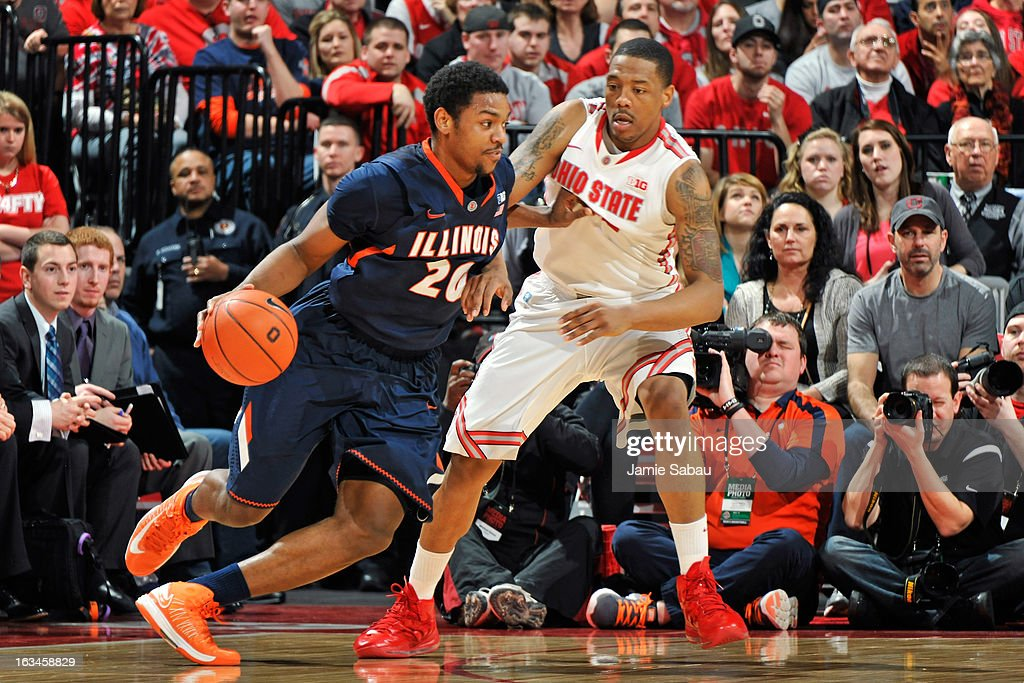 Myke Henry #20 of the Illinois Fighting Illini is fouled while driving to the basket by Nnanna Egwu #32 of the Illinois Fighting Illini in the second half on March 10, 2013 at Value City Arena in Columbus, Ohio. Ohio State defeated Illinois 68-55.