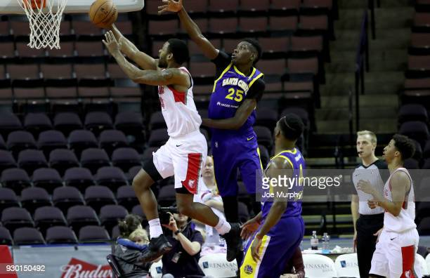 Myke Henry of the Memphis Hustle dunks against Chris Boucher of the Santa Cruz Warriors during an NBA GLeague game on March 10 2018 at Landers Center...