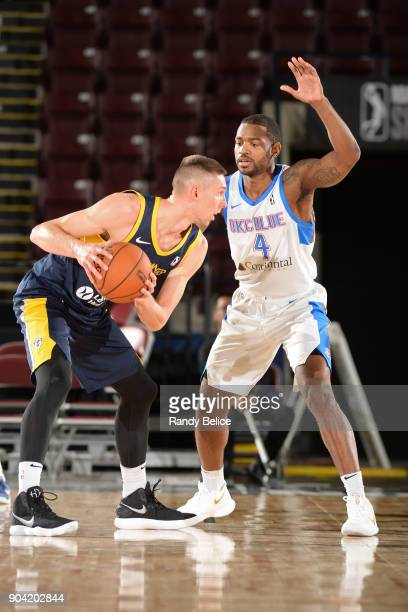 Myke Henry of the Oklahoma City Blue plays defense on Jarrod Uthoff of the Fort Wayne Mad Ants during the NBA GLeague Showcase on January 11 2018 at...