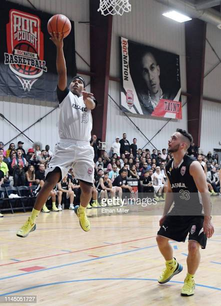 Myke Towers of Team El Combo drives to the basket ahead of C Tangana of Team La Familia during Roc Nation's Roc da Court allstar basketball game...