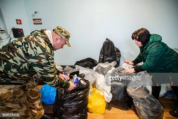 Mykola Anatoliyovych and his wife show packs with clothes bought and sewed by volunteers Packs will be sent to Ukrainian soldiers fighting in ATO...
