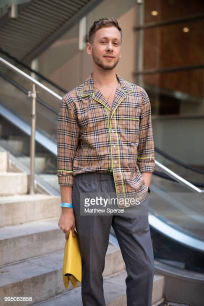Mykola Hruts is seen on the street attending Men's New York Fashion Week wearing Burberry shirt, Club Monaco pants and Topshop shoes on July 9, 2018...
