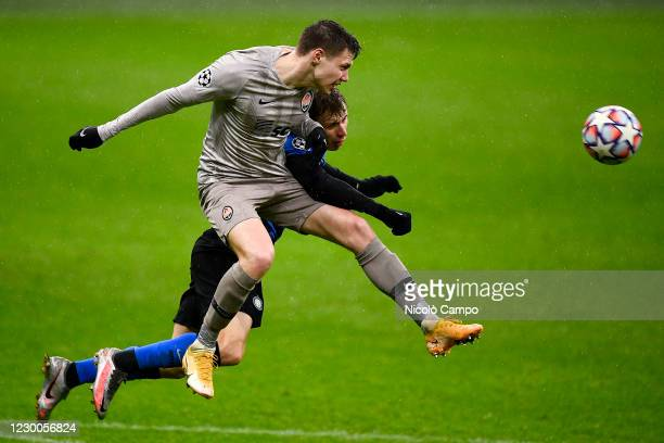 Mykola Matviyenko of FC Shakhtar Donetsk competes with Nicolo Barella of FC Internazionale for a header during the UEFA Champions League Group B...