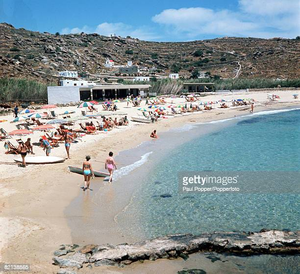 Mykonos Greece Circa 1960's Holidaymakers on the beach at Plati Yalos on the Greek Island in the Aegean Sea