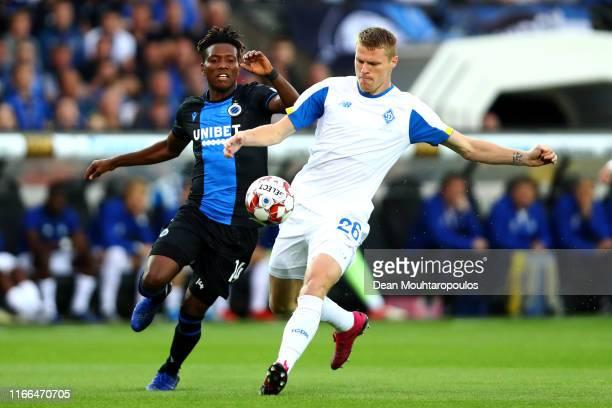 Mykyta Burda of Football Club Dynamo Kyiv battles for the ball with David Okereke of Club Brugge KV during the UEFA Champions League, Third...