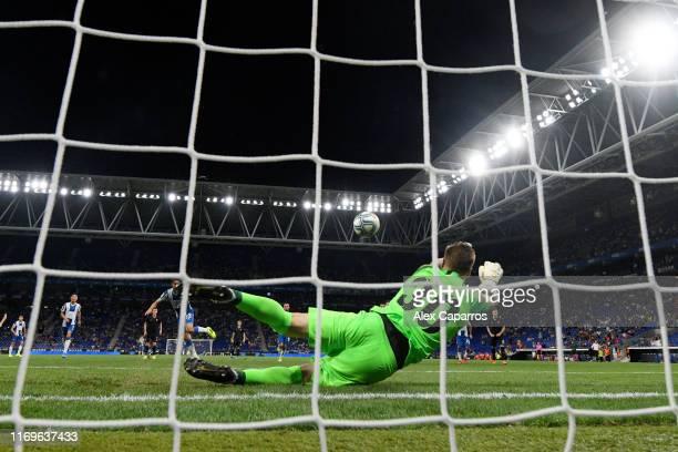 Mykyta Shevchenko of Zorya Luhansk saves a penalty from Esteban Granero of Espanyol during the UEFA Europa League Play Off match between Espanyol and...
