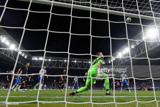 Mykyta Shevchenko of Zorya Luhansk watches the ball as a shot from Wu Lei of Espanyol hits the post during the UEFA Europa League Play Off match...