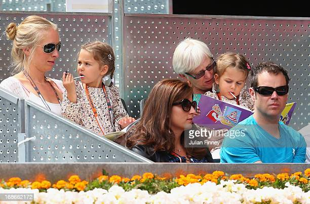 Myla Rose and Charlene Riva with mother Mirka Federer watch as Roger Federer of Switzerland plays Radek Stepanek of Czech Republic during day four of...