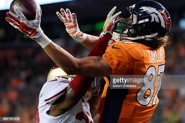 Mylan Hicks of the San Francisco 49ers commits pass interference in the end zone on Jordan Taylor of the Denver Broncos which would set up the...