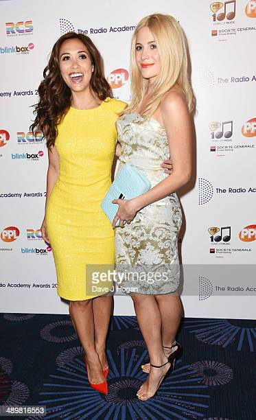 Myleene Klass and Pixie Lott attend The Radio Academy Awards at The Grosvenor House Hotel on May 12 2014 in London England