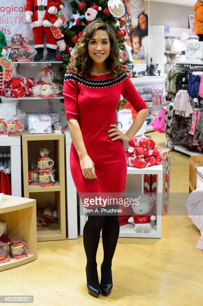 Myleene Klass attends a photocall ahead of a VIP Christmas party at the newly refurbished store Mothercare Oxford Street on November 28 2013 in...