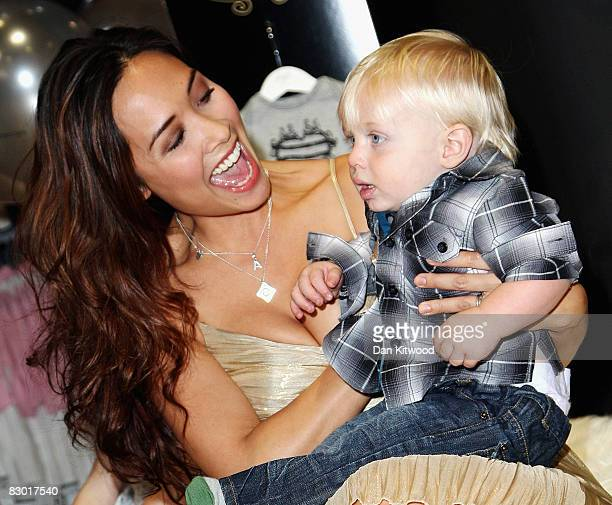 Myleene Klass poses with oneyearold Michael Edwards at the launch of her new 'Baby K' clothing range at Mothercare on Oxford Street on September 26...