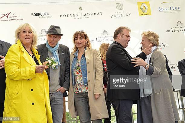 Mylene Demongeot, a guest, Julie Debazac, Dominique Besnehard and Marie Christine Barrault attend the 'Journees Nationales du Livre et du Vin 2014'...