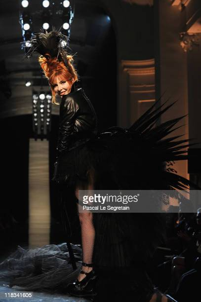 Mylene Farmer walks the runway during the Jean Paul Gaultier Haute Couture Fall/Winter 2011/2012 show as part of Paris Fashion Week on July 6 2011 in...