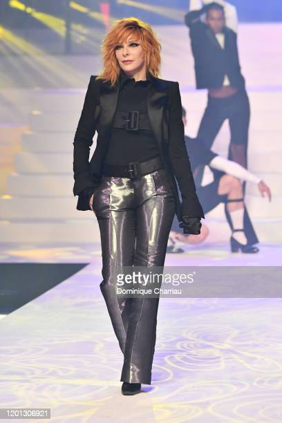 Mylene Farmer walks the runway during the JeanPaul Gaultier Haute Couture Spring/Summer 2020 show as part of Paris Fashion Week at Theatre Du...
