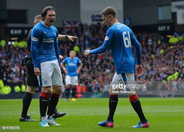 Myles Beerman of Rangers looks dejected after fouling Patrick Roberts of Celtic leading to a penalty with Josh Windass of Rangers during the...